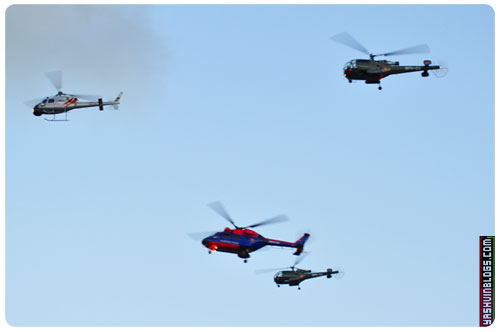 The 3 helicopters going forward while the red-blue one going on reverse