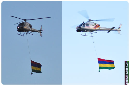 2 helicopters carrying the flag