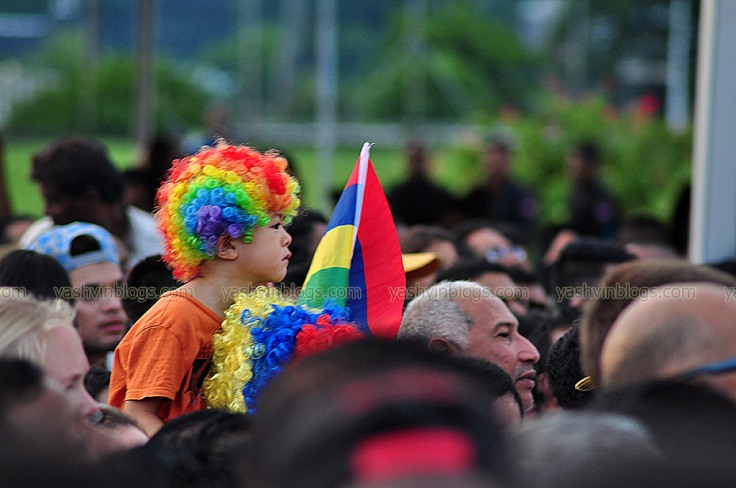 The kid with his flag and colored wig...