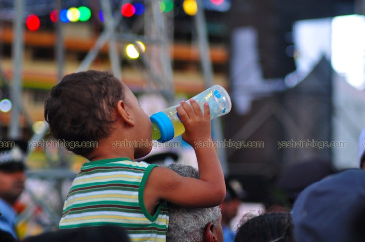 A kid with his feeding bottle